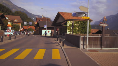 A panning shot following a bycyicle past the Alder de la Gare hotel in Brienz, Switzerland