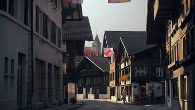 Cars traveling down Hauptstrasse road, Brienz, Switzerland