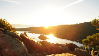 Timelapse shot of the sunrise seen over Emerald Bay and Nevada desert with lens flare