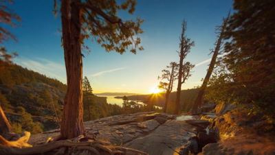 Timelapse tilting shot of the sunrise over a Emerald Bay in Nevada with lens flare