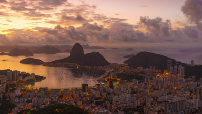 Sunrise time-lapse of Sugar Loaf mountain from behind Rio.