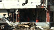 Men Clear Debris From Building After Tsunami In Kesennuma City Japan