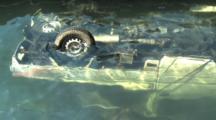 Japan Tsunami Aftermath - Van Lies Submerged In Sea In Kesennuma City Japan