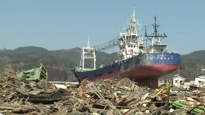 Japan Tsunami Aftermath - Large Ship Lies Amidst Burnt Wasteland In Kesennuma City