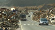 Japan Tsunami Aftermath - Debris Pilled Along Side Of Road In Rikuzentakata
