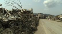 Japan Tsunami Aftermath - Debris Piled By Side Of Road In Downtown Rikuzentakata City