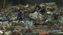 Japan Tsunami Aftermath - Survivors Walk Through Destroyed Downtown Rikuzentakata City