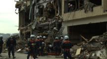 Japan Tsunami Aftermath - Rescue Team Retrieve Body From Destroyed Building In Rikuzentakata City