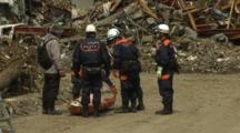 Japan Tsunami Aftermath - Man Identifies Dead Body In Rikuzentakata City