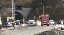 Japan Tsunami Aftermath - Fire Trucks Race Along Street In Ishinomaki City