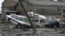 Japan Tsunami Aftermath - Cars Lie In Mud In Street In Ishinomaki City
