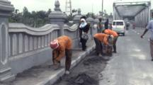 Workers Scrape Volcanic Ash From Bridge After Major Eruption Of Merapi