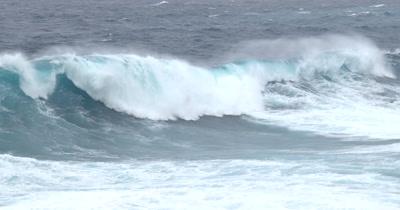 Tracking Shot Huge Hurricane Wave Crashing Into Cliffs