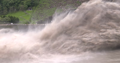 Flood Waters Blast At Dam Hydroelectric Plant
