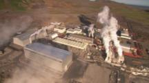 Aerial Over Geothermal Power Plant, Cars Leaving