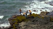 Looking Down On Young Boys Jumping Into Ocean, Spear Fishing