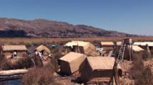 High Angle Pan Of Floating Reed Island In Lake Titicaca