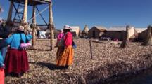 Travel Past Indigenous Women On Floating Reed Island, Pass Reed Boats