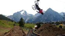 A Slow Motion Shot Of A Mountain Biker Doing A Backflip And Crashing.