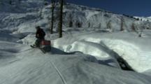 Snowmobiler Drives Away.