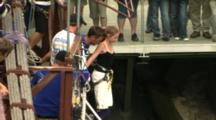 A Young Girl Bungy Jumps Off A Bridge.