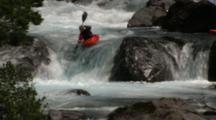 Kayaker Drops Over Rapid