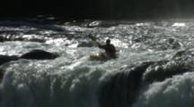 A Kayaker Does A Wave Wheel Over A Big Waterfall.