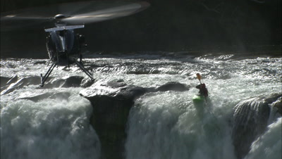 A Kayaker Goes Off A Big Waterfall.