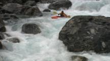 Kayaker Paddles Full Series Of Rapids