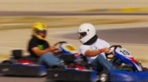 Close Up Of Go Karts Racing On A Track.