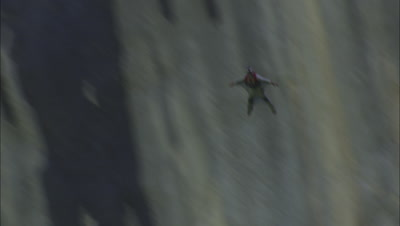 Man Base Jumps Off Huge Cliff Wall With Wing Suit.