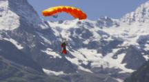 Man With Wing Suit Base Jumps Off A Cliff.