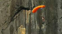 Base Jumper In A Wing Suit Jumps From A Cliff.