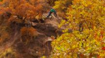 Wide Of A Mountain Biker Hitting A Step Up Jump.