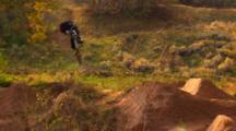 Wide Of A Mountain Biker Crashing On A 360.