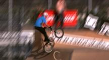 Tracking A Bmx Rider Doing Big Tricks At A Skate Park.