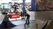 Tracking A Bmx Rider Doing A 360 Transfer At A Skate Park.