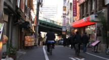 Time Lapse Of People And Traffic On Narrow Japanese City Street.