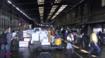 People Working In A Busy Fish Market Warehouse.