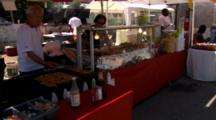 Food Vendor Cooking Chicken Skewers.