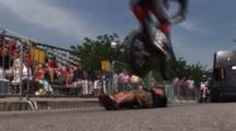 Wide Of A Motocross Rider Jumping Over A Person.