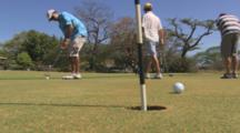 Close Up Of A Golfer Making A Putt.