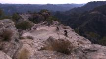 Overlook Of Mountain Bikers Riding On A Mesa.