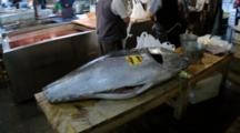 A Big Tuna Carcass Placed On Table At Tsukiji Market In Japan