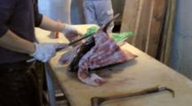 Man Cutting Fresh Tuna Head With Knife At Tsukiji Market In Japan