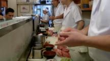Chef Making Sushi In A Sushi Restaurant