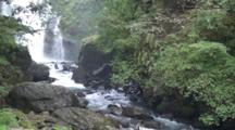 Waterfall Flows To Creek Or River, In Forest In Urai, Taiwan