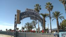 People Walk Under Santa Monica Yacht Harbor Gate