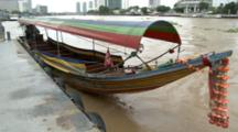 Colorful Longtail Boat Is Tied To Pier