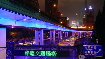 Car Running on the Road at Night in Shanghai, China